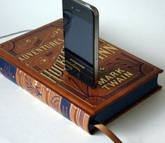 Book Chargers by Rich Neeley Designs are made from actual vintage books outfitted with an impressively subtle power source for an iPhone or iPod. The USB-compatible hook-up tucks neatly behind the book's binding, and the dock itself is discreet enough to go unnoticed at quick glance. $48-$55 per book