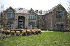 """The """"smart"""" home is on 8.9 wooded acres with 12,000 square feet overlooking a 1-acre private pond. Mahogany doors open to a 2-story foyer with marble floors and a curved-iron staircase. The gourmet kitchen features a 60-inch range, cherry cabinets, 2 refrigerators, a walk-in pantry, granite counters and a separate prep area. Enjoy elevator access to the finished walk-out basement with a home theater."""