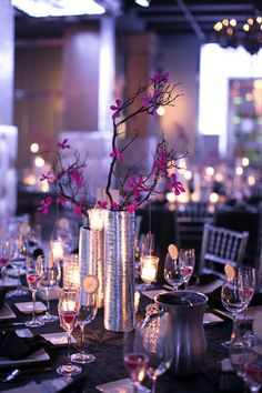 Silver cylinders filled with purple dendrobium orchid branches; Wedding at Tendenza of Cescaphe Event Group