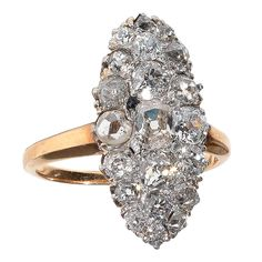 A Late Victorian Diamond Cluster Ring,Of marquise panel design, set throughout with old brilliant-cut diamonds  mounted in 18 carat yellow gold and silver,Circa 1890