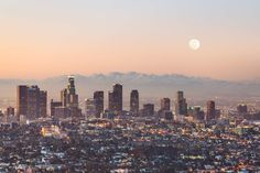 Our LA Skyline Wallpaper features bright lights and skyscrapers with the the moon and the breathtaking clouds perfectly depicting the lively city.
