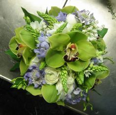 green wedding bouquet.  Flowers of Charlotte loves this!   Find us at www.charlotteweddingflorsist.com for more information on weddings and events in Charlotte, NC
