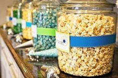 popcorn bar at she's about to pop baby shower theme--ribbons on jars are so cute. I wonder if anyone has any of these jars?