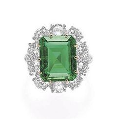 AN EMERALD AND DIAMOND RING, BY VAN CLEEF & ARPELS   Set with a cut-cornered rectangular-cut emerald, weighing approximately 6.83 carats, within a circular-cut diamond surround, to the circular-cut diamond shoulders and platinum hoop, mounted in gold and platinum  Signed Van Cleef & Arpels, N.Y., no. 43367