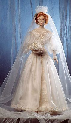 Varya (The Bride) doll by Alexandra Koukinova  A wedding dress made in style of 1901- 1904 years.    Biscuit porcelain, silk, laces, pearls, mohair.     The orange blossom is made on ancient technology as it was done 100 years ago.    Hand painting.