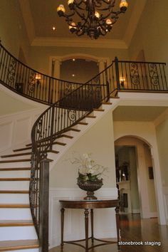 Megan...here's an idea..If you have a curved wall in your entry foyer, a round table works best. The curve of the table follows the curve of the wall.