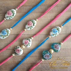 Turquoise & pink floral rakhis adorned with Japanese beads and pearls . Eazelly : Hand made, Heart made and Thoughtfully sourced: RAKHIS BE-JEWELED