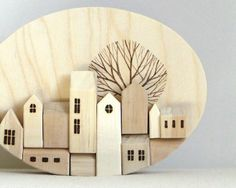 Little miniature houses….they are so cute. Ofcourse houses and homes they are my passion so can I resist not buying these little ones??? The houses are handmade and created of scrap wood and shaped into little peaked houses.  They sure would look great in a home, so if you are hooked like I