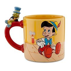 "New Disney Store 25th Anniversary Pinocchio and Jiminey Cricket Mug. Pinocchio and Figaro Art on reverse side. 25th Anniversary logo on the interior. 3 1/2"" H x 3 1/2"" D. 12 oz. size Ceramic. Dishwasher and Microware safe."