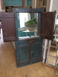 Late 18th century mirrored window with small doors. @Susan Osbourne. Sold