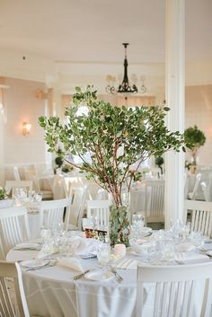 26 Refreshing Spring Wedding Centerpieces: a simple yet stunning centerpiece with fresh greenery on branches is great idea for any season Tree Branch Centerpieces, Greenery Centerpiece, Floral Centerpieces, Floral Arrangements, Candle Centerpieces, Centrepieces, Vases, Spring Wedding Centerpieces, Wedding Decorations