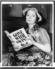 "Margaret Mitchell holding her book, ""Gone with the Wind."""