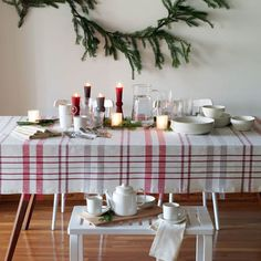 Market Plaid Tablecloth | Unison | Be mad for plaid--winter, spring, summer, or fall. And especially during the holidays. Top off the warm look with Teema white dinnerware, an everlasting design classic.