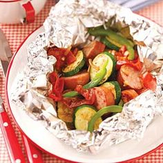 Sausage Vegetable PacketsPerfect for grilling in the backyard or cooking on camping trips, these recipes for potatoes, veggies, fish and more food made in foil packets make serving easy and cleanup a breeze Tailgating Recipes, Grilling Recipes, Pork Recipes, Cooking Recipes, Healthy Recipes, Burger Recipes, Cooking Ideas, Grilling Tips, Yummy Recipes