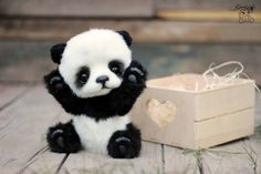 Panda bear Hugo handmade plush collectible artist stuffed teddy bear Panda Hugo Collectible artist stuffed teddybear 25cm Panda Bear made from qualitative faux fur. 5-way disk-jointed. glass eyes Fully jointed and stuffed with sintepon and metall granulate for a nice weighted feeling when he