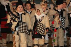 """Christmass and New Year Traditions in Moldova: The Caroling The Caroling in Romanian language is called """" Colindatul"""" Traditionally, during the first hours after dark on Christmas' Eve is the time for. New Years Traditions, Christmas Traditions, Moldova, Folk Costume, After Dark, Fur Coat, The Incredibles, Traditional, Concert"""