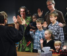 Commissioner Martha Gross, left, swears in the Jakobitz family, mom Julie holding Hava, 2, Micah, 9, dad Jonathan, Uriah 11, Hadassah, 6, and Asher 3, while the Lynden family adopted Hava at the Whatcom County Court in Bellingham, Friday morning, Nov. 9, 2012. 23 children were formally in Whatcom County on National Adoption Day.