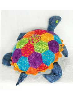 "An adorable friend for children. This precious turtle pattern makes for a great carry-along item for children. You can insert a pillow to make him extra cushiony or use him to store pajamas or toys. Make him scrappy or coordinate him with bedroom decor, this turtle is precut friendly as well. The hexagons are sewn with no Y seams. Pattern includes templates and full instructions with diagrams for piecing. Use at least 36 (5"") squares, plus yardage to finish your turtle."