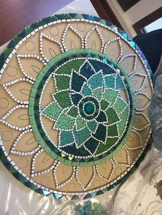 Mandala shape - Martin Alejo Mangeaud - Table top, stepping stone in a simpler design, coaster, loads of uses for this pattern.free mosaic patterns for tables RoundI think this would make a great hooked chair padLove the tranquil colours.