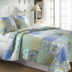 """Reversible cotton patchwork quilt set.  Product:  Twin: 1 Quilt and 1 standard sham  Full/Queen: 1 Quilt and 2 standard shams King: 1 Quilt and 2 king shams Construction Material: CottonColor: Jade and multiFeatures:   Squares of updated floral and stripe patterns  Double diamond stitching enhance the quilt's softness  Reverses to a coordinating floral print  Oversized for better mattress coverage    Dimensions:  Standard Sham: 20"""" x 26"""" each King Sham: 20"""" x 36"""" each  Twin Quilt: 68"""" x 88""""…"""