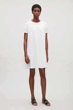 This oversized dress is made from soft and stretchy cotton jersey with a contrast poplin panel around the hemline. A flared shape, it has a simple round neckline, dropped shoulder seams and short kimono sleeves.