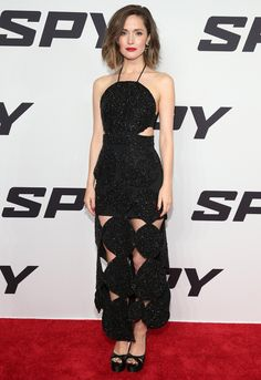 Rose Byrne wearing a sparkling black Osman design with bold, graphic cut-outs carved at the bodice and up the hemline at the Spy premiere - May 2015.