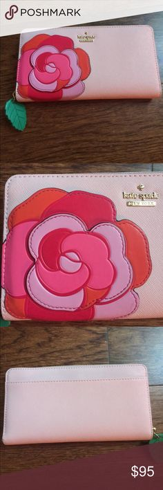SALE🎉KATE SPADE ♠️ PINK FLOWER WALLET 1 day SALE🎉 KATE SPADE ♠️ Pink Flower wallet 🌸 12 slots for credit cards. Five slots for papers cash etc. pocket in the Center for change.  There's an additional large lot in the back side. The zipper is a leaf.  The flower colors are pink, dark pink, orange, and purple. Excellent used condition only used for 2 weeks.  No stains or damage. kate spade Bags Wallets