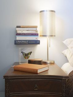 Love this floating shelf of books by the bed to keep them off of the bedside table!!!