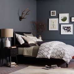 Master Bedroom  - Black bed black nightstand, gray walls, gray or white trim. White frames.