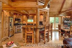 Beautiful kitchen in the Lofted Log floor plan. Photos and floor plans are at www.GoldenEagleLogHomes.com #loghomeliving #construction #loghomes #loghome #logcabins #cabin #logcabins #home #homes #houzz #outdoors #nature #rusticliving