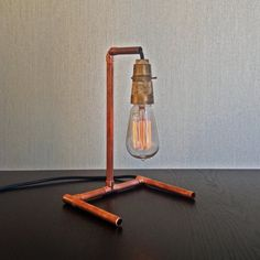 With a minimalist design and a raw copper look, this lamp speak for itself. It would fit nicely on your work desk, kitchen bench top, or as a pair on