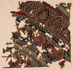Fragment   15-16C   This fragment is one of many hundreds of printed cotton fabrics from Gujarat which have been recovered from several sites in Egypt. This one (like the others in the V's collection) reputedly came from Fostat, the former capital of Egypt, which has given its name to the whole group, which are often referred to as 'Fostat fragments'. Such textiles formed part of an extensive Indian trade with the Arab world conducted through the ports of Western India.