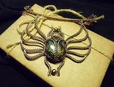 Magnificent handcrafted scarab! Wire wrapped necklace of copper and brass with labradorite. Size of the scarab is 2.9 to 3.2 inches. Bar is 4.2 inches Chain length is 14 inches (I can make it longer if you like) Materials: copper, brass, natural labradorite