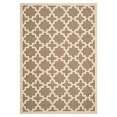 Anchor your patio furniture or add a pop of pattern to your foyer with this versatile rug, showcasing a tile-inspired trellis motif.   Product:  RugConstruction Material: PolypropyleneColor: Brown and boneFeatures:Suitable for indoor and outdoor use Made in TurkeyNote: Please be aware that actual colors may vary from those shown on your screen. Accent rugs may also not show the entire pattern that the corresponding area rugs have. Cleaning and Care: Sweep, vacuum, or rinse off with a garden…