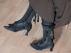 Black spats gaiters with ruffled trim in taffeta fabric. $90.00, via Etsy.