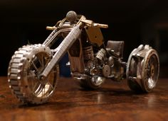 Tiny motorcycles made out of watch parts. Very cool look.    http://www.thisiscolossal.com/2012/07/watch-part-motorcycles/