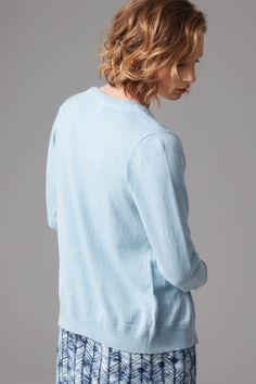 Crafted in a natural blend of cotton with the added luxury of cashmere, creates this beautifully soft and easy care knit. Featuring pretty herringbone design detail, ribbed hem and cuffs and finished with our signature Wild South branded buttons and metal tag. Wear yours layered over your favourite tee or summer dress. Available in sky blue, blossom pink and navy.