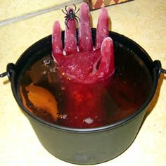Halloween party, look out for frozen hands in the punch!   Freeze a plastic glove.    Part of me says  Ewwww.  Part of says... way cool. !!!  - Full DIY and recipe at link.
