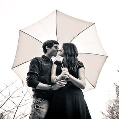 If it starts to rain during engagements-This would be even more cute if the wedding date was written on the umbrella!!