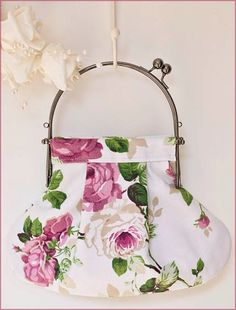 Rose Print Purse Handbag by CrystalMoonCat on Etsy, $30.00  -  Small vintage inspired handcrafted handbag in pretty pink rose printed linen. It has a pewter coloured metal loop purse frame and is lined in a soft apple green cotton.
