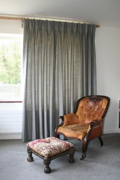 Hamada Stripe-Granite pinch pleat curtains. Granite is a charcoal grey, natural and white striped linen.This gives a cool sophisticated look and compliments natural wood and warm earthy tones.