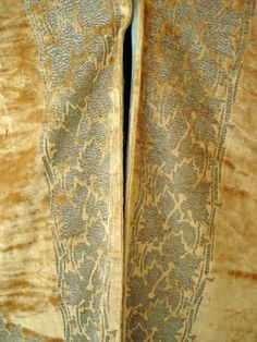 Rare early 20th century Fortuny velvet coat fashioned of rich shades of gold panne silk velvet heavily stenciled in silver Islamic scrolls in a kimono inspired style