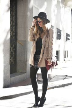 camel trench, big black hat and mini tweed pen skirt