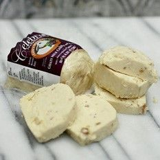 From the same maker as the much-raved-about Cranberry and Blueberry Chevres comes this Fig Chevre from Canada. Unlike the former two, which had their fruit pressed into the rind, Fig Chevre has pureed figs mixed throughout its creamy, tangy interior. The flavor of fresh goat cheese has long been paired with the almost molasses-like sweetness of figs. This chevre roll is the perfect way to enjoy this combination during any season!