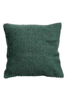 Copricuscino a punto riso: Copricuscino in maglia lavorata a punto riso con retro in tessuto di cotone. Cerniera nascosta.