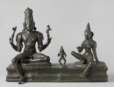 Anonymous | Somaskanda, Anonymous, c. 1100 | De compositie bestaat uit drie figuren geplaatst op een voetstuk. De vierarmige Siva zit in de zogenaamde lalita-asana-houding (waarbij het ene been naar beneden hangt). Zijn rechter voorarm laat het gebaar van de geruststelling (abhaya-mudra) zien; de linker voorarm is in de kataka-mudra. De andere twee armen houden een bijl (rechts) en een hert (links), bekende attributen van Siva in Zuid-India. De god is vergezeld door zijn echtgenote Uma…
