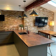 By using brick slips, an exposed steel beam and our worn copper effect Rouille Zenith worktop, this customer has created a flawless… Kitchen Room Design, Home Decor Kitchen, Interior Design Kitchen, Home Kitchens, Open Plan Kitchen Dining Living, Open Plan Kitchen Diner, Living Room Kitchen, Exposed Brick Kitchen, Brick Slips Kitchen