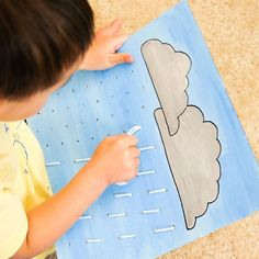 DIY toy for preschoolers to learn sewing. 'Rain' threading activity.