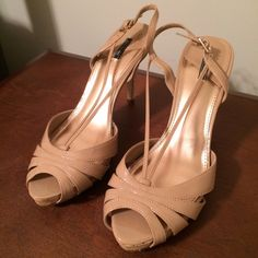 "Nude Strap Heels Practically new. Worn once. Neutral nude color. Buckle strap. Really cute cork design on heel and platform. 4"" heel height with less than 1"" platform. Size 9.5M. EUC. (More pics coming soon.) Daisy Fuentes Shoes Heels"