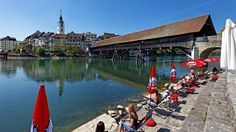 view to the town Olten and the wooden bridge Countryside Fashion, Switzerland Tourism, The Mont, Covered Bridges, Travel Europe, Rocky Mountains, Alps, Continents, Wonders Of The World